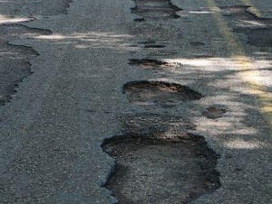 635913058488571990-potholes.jpg