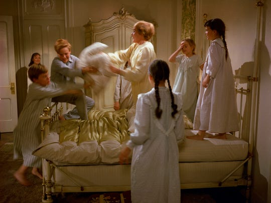 Julie Andrews, center, as Maria, with Duane Chase,