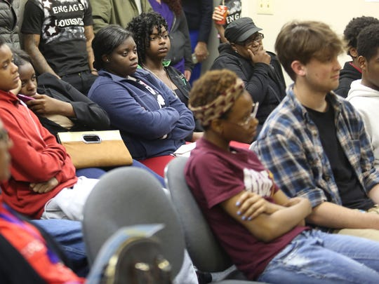 Attendees at a job fair at the Kentucky Youth Career Center in downtown Louisville on Tuesday look on as speakers answer questions.