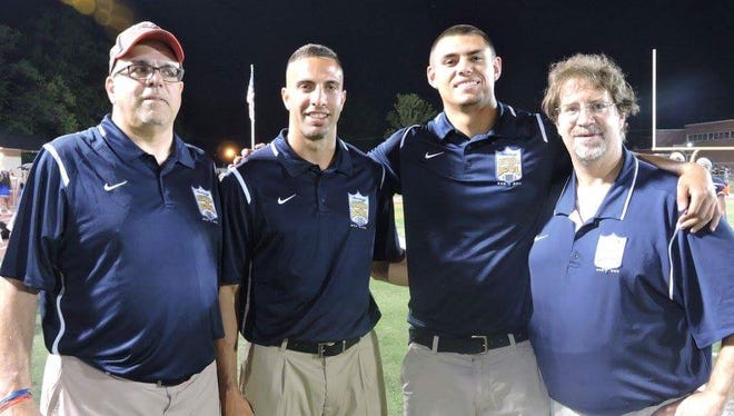 Joe LaSala, second from left, has been named Woodbridge High School's new head football coach. LaSala is pictured with his father, Ben (left), Anthony Nyers and Bill Nyers (right) during the 2016 Snapple Bowl.