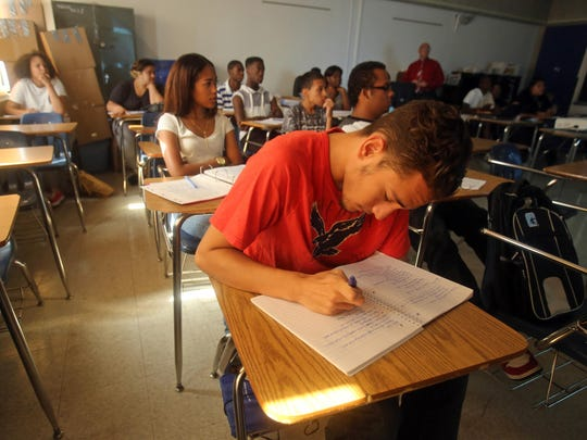 Diego Mendez takes notes during a U.S. History summer school class at Yonkers High School. A 2005 state audit found that between 1993 and 2003 the city's own share of school funding fell from 43 percent of the district budget to 32 percent.