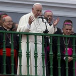 Pope Francis speaks to people gathered outside the Metropolitan Cathedral in Santiago de Cuba on Tuesday.