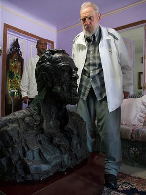 In this July 22, 2014 file photo, Fidel Castro looks at a sculpture of himself, a gift from China's President Xi Jinping in Havana, Cuba. Amid the excitement over the thaw in U.S.-Cuba relations, one person has been conspicuously absent: Fidel Castro. The former Cuban president hasn't made any public comment about the announcement that the U.S. and Cuba will restore diplomatic relations after more than 50 years of hostility.