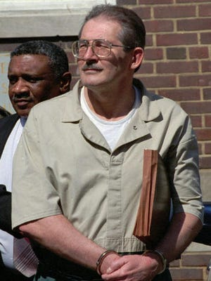 FILE - In this April 28, 1994 file photo, former CIA agent Aldrich Ames leaves federal court in Alexandria, Va. U.S. relations with Moscow during and after the Cold War have been marred by diplomatic dustups ranging from espionage scandals to an Olympics boycott. In February 1994, the U.S. expelled Russian senior intelligence officer Alexander Lysenko, saying he was in a position to be responsible for the spying of CIA agent Ames. This was just days after Ames and his wife, Rosario, were arrested on charges of selling secrets to Moscow from at least 1985 to 1993.