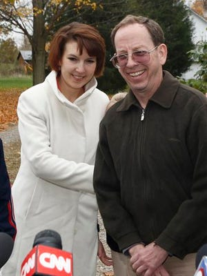 Jeffrey Fowle, right, stands with his wife Tatyana Fowle at their home in West Carrollton, Ohio, Wednesday, Oct. 22, 2014.