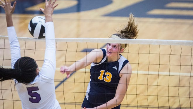 Delta's Molly Hunt hits against Central's defense during their game at Delta High School last season. Hunt was on the national title-winning 16 Open team