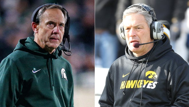 Mark Dantonio (left) of Michigan State and Kirk Ferentz of Iowa.