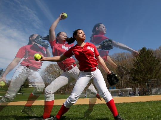 North Rockland pitcher Kayla McDermott warms up before