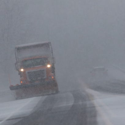 A DelDOT plow at work on Airport Road near New Castle.