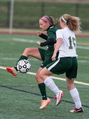 Parkside's Torri Appel (6) attempts to move the ball past Queen Anne's Taryn Patrick (15).