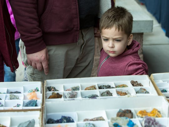 Emery Axtell, 2, of Las Cruces looks at the colorful