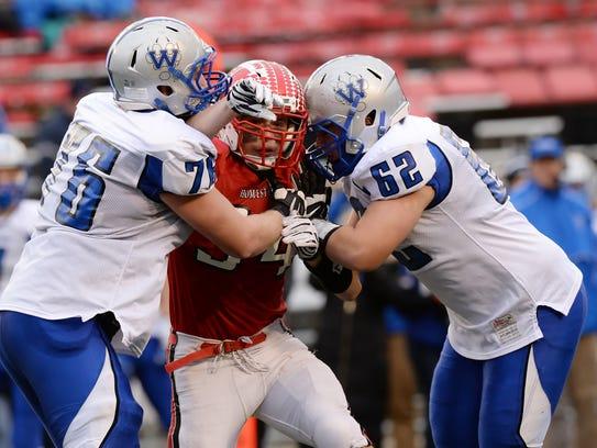 Homestead's Mike Bruner battles through a double team