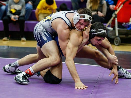 Kettle Moraine wrestler Michael Burgireno (top) battles