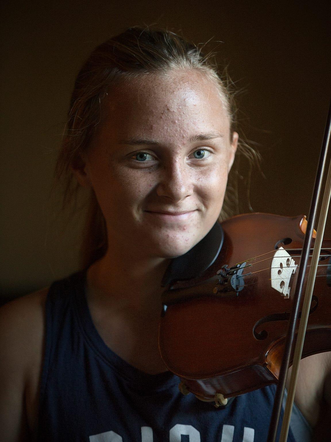 Caroline Kavanaugh poses with her violin for a portrait