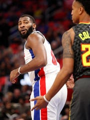 Pistons center Andre Drummond (0) looks at Hawks forward John Collins (20) after making a basket during the first quarter on Friday, Nov. 10, 2017, at Little Caesars Arena.