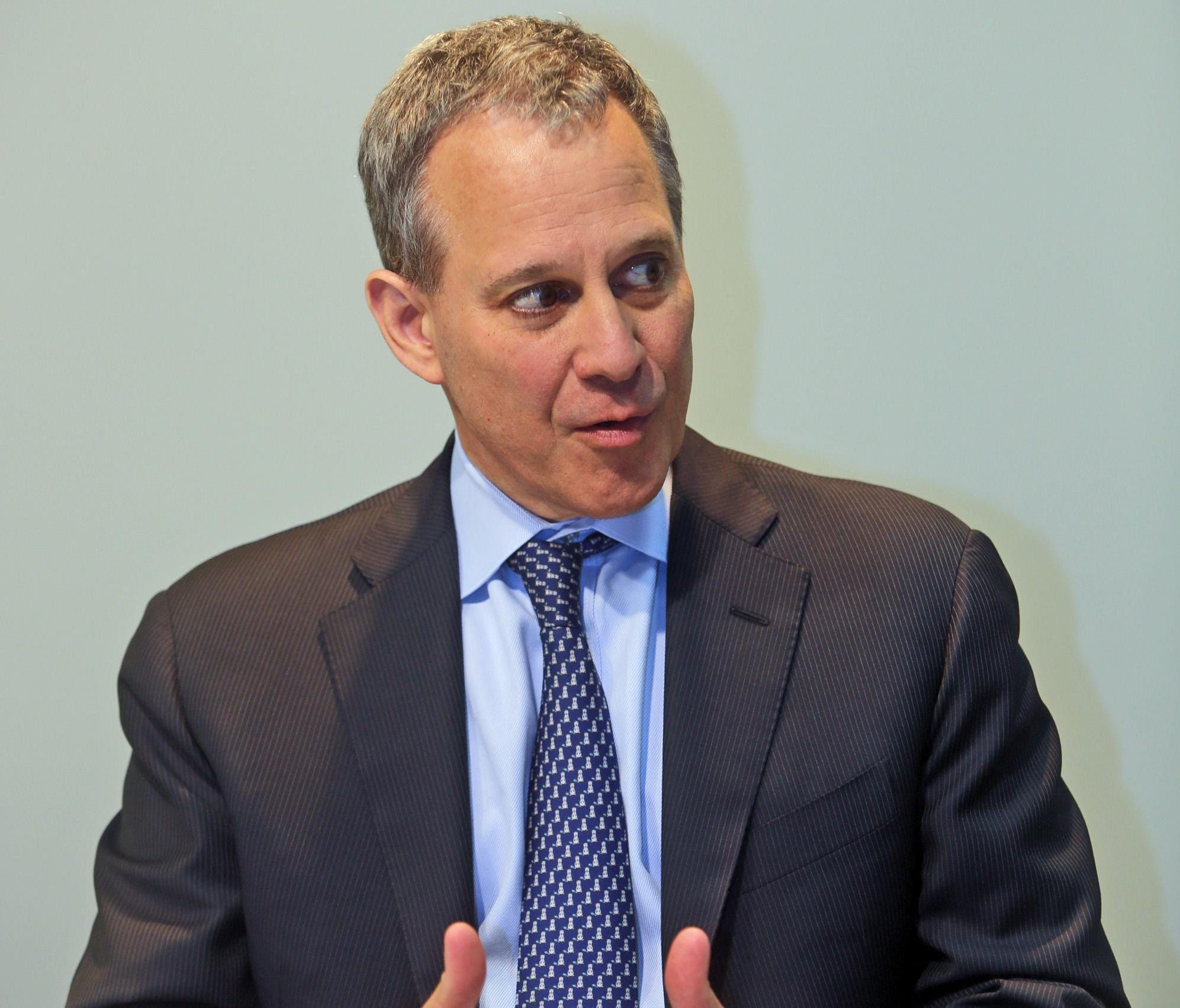 New York State Attorney General Eric Schneiderman speaking with reporters and members of The Journal News editorial board Aug. 20, 2014.