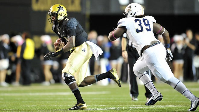 Vanderbilt quarterback Johnny McCrary (2) is chased by Charleston Southern's Anthony Ellis in the second quarter Saturday.
