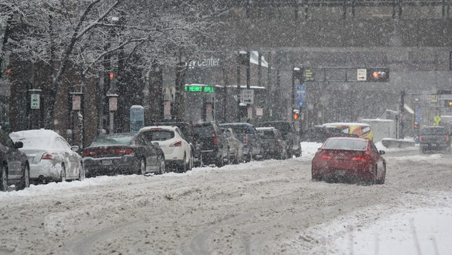 Elm Street was covered with a thick layer of slush around 4 p.m. Saturday.