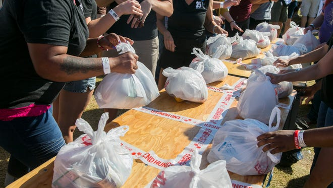 Hunger backpacks are set on the table after a record-setting packing for children who are on the free or reduced-price lunch program in school sponsored by Republic Media and the Valley of the Sun United Way  in Tempe, AZ on Saturday, Oct. 25, 2014.