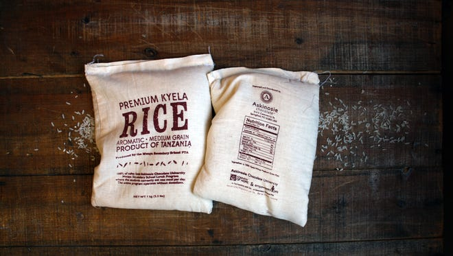 The sales of the medium grain white rice provide daily lunches to malnourished students in remote Southwestern Tanzania, where Askinosie sources cocoa beans.
