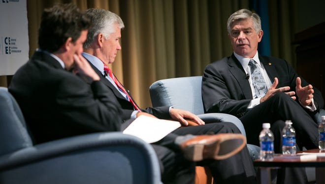 Patrick T. Harker (right), president and chief executive officer of the Federal Reserve Bank of Philadelphia, joins a panel discussion at the University of Delaware's 2016 Economic Forecast at the Clayton Hall Conference Center in Newark.