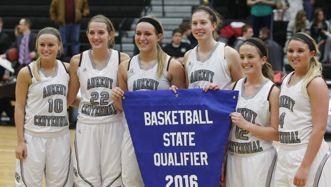 The six seniors on the Ankeny Centennial girls' basketball team pose with their state qualifier banner after the Jaguars posted a 66-42 victory over Sioux City West in a Class 5-A regional final on Tuesday. From left are Meg Brandt, Haley Matter, Kendyl Lindaman, Tasha Vipond, Maddy Fiene and Sammy Stoelk.