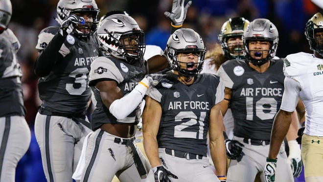 Air Force's Jesse Washington (21) is congratulated by teammates after intercepting a pass by CSU quarterback Nick Stevens in the second quarter of Saturday night's game at Falcon Stadium.