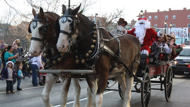 Santa Claus closes boscov's out the Downtown Holiday Parade on Saturday.