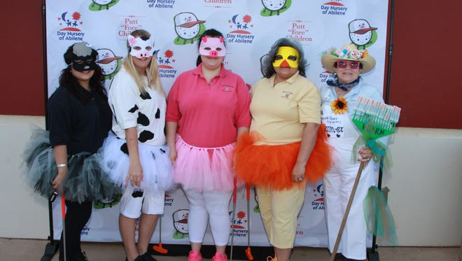 Barnes and Williams Pharmacy staff members as �Pharm Animals� at the Putt �Fore� Children Miniature Golf Tournament.
