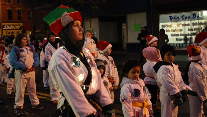 Gabe O'Donnell, 11, of Fairbanks Karate of Vestal, perfors a karate sequence during Saturday's Endicott Holiday Parade.