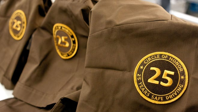 UPS announced that 14 of its 47 elite drivers from New Jersey are among 1,575 newly inducted worldwide into the Circle of Honor of UPS drivers who have achieved 25 or more years of accident-free driving. Pictured are the patches the elite drivers were.