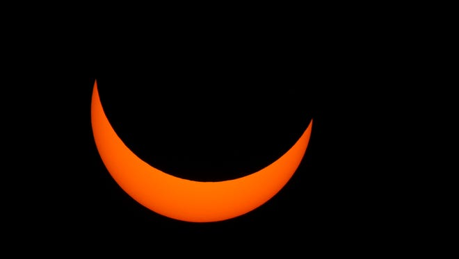 The solar eclipse as seen from the Pink Shell Resort at Fort Myers Beach on Monday, August 21, 2017.