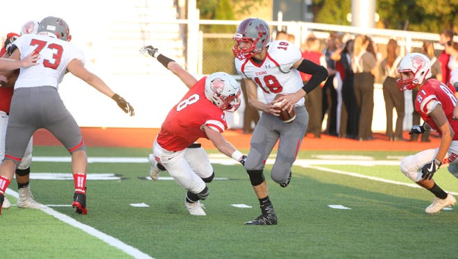 Port Clinton's Gunar Zink, left, and Tim Paradiso, right, love one thing more than chasing quarterbacks. Catching them.