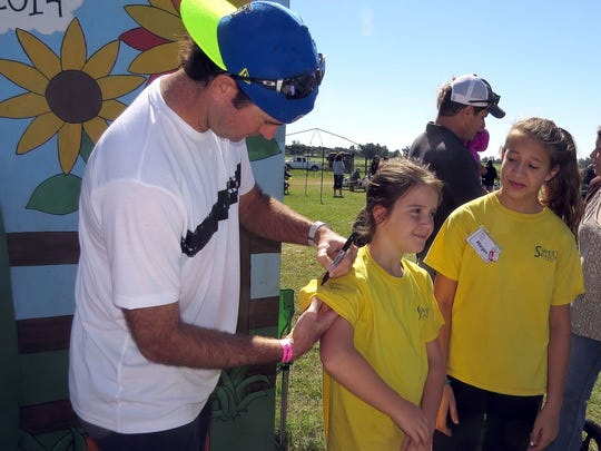 Bubba Watson signs autographs with his young fans at Sweet Season Farms corn maze.