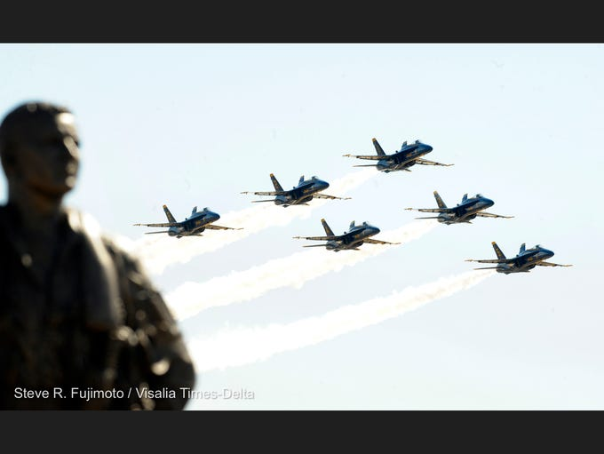 The Naval Air Station Lemoore Aviators Memorial Association unveiled the Aviator Memorial, left, Saturday to honor the fallen pilots who've come from NAS Lemoore. The Blue Angels, pictured, honored the Navy's newest memorial Monday with a fly over.