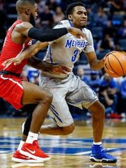 Memphis guard Jeremiah Martin (right) is fouled by