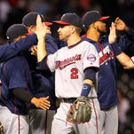 Minnesota Twins second baseman Brian Dozier (2) celebrates with teammates after defeating the Chicago White Sox on Tuesday at U.S. Cellular Field in Chicago.