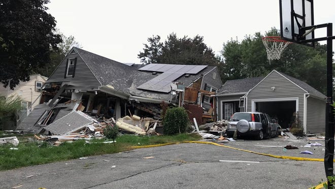 A house is destroyed in Lawrence, Mass., Thursday, Sept. 13, 2018 after a series of gas explosions in the area. First-responders continued to fight at least 50 fires in Lawrence, Andover and North Andover Mass., Thursday. The fires are being attributed to problems with the natural gas system and officials are urging residents to leave their homes if they smell gas. (Carl Russo/The Eagle-Tribune via AP)