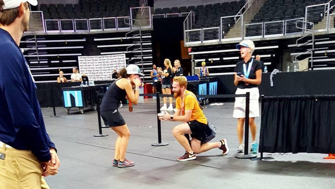 Mike Snyder proposes to his girlfriend, Charlotte Wood, at the finish line of the Sioux Falls Marathon on Sunday, Sept. 10, 2017.