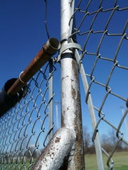 The fencing around Lion's Field is in need of repair in places and non-existant in other place.