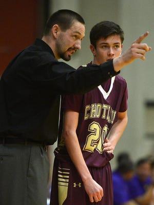Choteau coach Matt Luedtke talks to Collin Achenbach in 2015 at the State B tournament in Great Falls.
