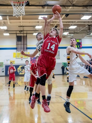 St. Philip's Justice Steiner (14) goes for the hoop during first half action against Climax-Scotts Friday evening.