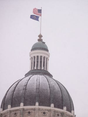 The Indiana Statehouse on a snowy day that saw about a half inch of snow by mid-day, Indianapolis, Friday, Jan. 12, 2018.