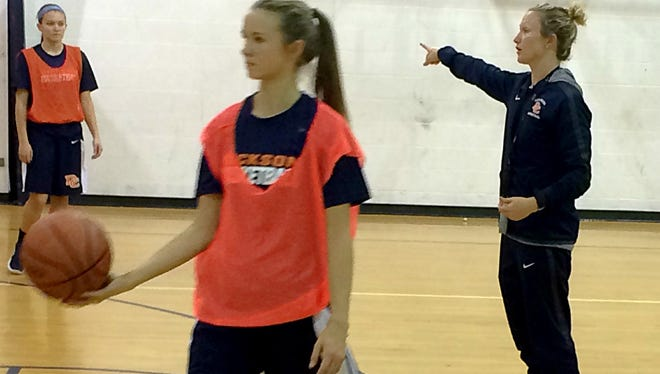 New Dickson County High School Lady Cougars head basketball coach Catie Embrey works with the team during a recent practice.