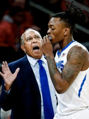 Memphis head coach Tubby Smith (left) talks to forward