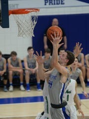 Lakeland's Cass Phillips goes up for a shot during the Class A semifinal won by Novi 74-55 at Salem High School on March 12.