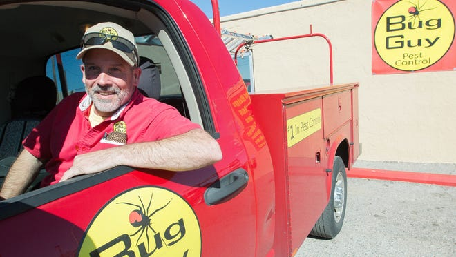 Jeff Murray, owner of Bug Guy Pest Control, sits in one of his fleet trucks in front of the Lohman Avenue office. Friday Feb 23, 2018