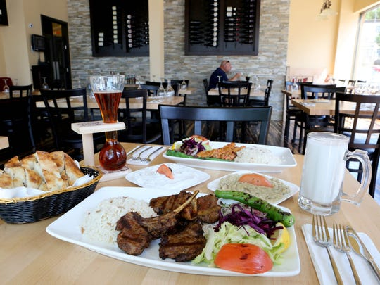 Lamb chops, pita bread, chicken adana kebab, baba ganoush, labneh, a beer and ayran (a cold yogurt beverage mixed with salt) at The Turk in Mount Kisco.