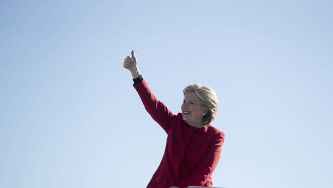 In this file photo, Democratic presidential candidate Hillary Clinton gives a thumbs up as she boards her campaign plane at Pittsburgh International Airport in Pittsburgh, Monday, Nov. 7, 2016, to travel to Michigan. (AP Photo/Andrew Harnik)