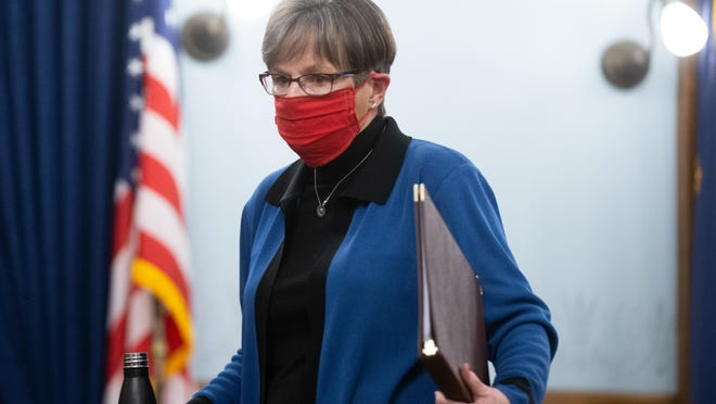 Gov. Laura Kelly walks out of a news conference Wednesday at the Statehouse where she issued an executive order regarding mask use.